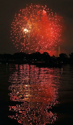 Fireworks illuminate the night sky and are reflected in the Potomac River with the Washington Monument at right on Monday, July 4, 2011 in Washington. &#40;AP Photo&#47;Alex Brandon&#41; <span class=meta>(AP Photo&#47; Alex Brandon)</span>