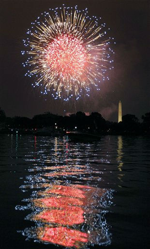"<div class=""meta ""><span class=""caption-text "">Fireworks illuminate the night sky and are reflected in the Potomac River with the Washington Monument at right on Monday, July 4, 2011 in Washington. (AP Photo/Alex Brandon) (AP Photo/ Alex Brandon)</span></div>"
