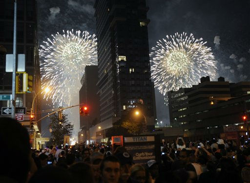 Spectators watch fireworks explode over the Hudson River from 42nd street during Macy&#39;s annual 4th of July fireworks show on Monday, July 4, 2011 in New York.  &#40;AP Photo&#47;Bill Kostroun&#41; <span class=meta>(AP Photo&#47; Bill Kostroun)</span>