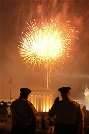 Police officers view fireworks explode over the Philadelphia Museum of Art during an Independence Day celebration Monday, July 4, 2011, in Philadelphia. &#40;AP Photo&#47;Matt Rourke&#41; <span class=meta>(AP Photo&#47; Matt Rourke)</span>
