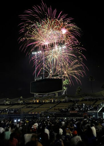 Fans watch fireworks after a baseball game between the New York Mets and the Los Angeles Dodgers, Monday, July 4, 2011, in Los Angeles. The Mets won 5-2. &#40;AP Photo&#47;Gus Ruelas&#41; <span class=meta>(AP Photo&#47; Gus Ruelas)</span>