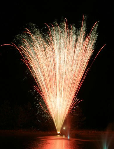 A fan of fireworks light up a lake in Bullard, Texas to celebrate Independence day on Monday  July 4, 2011. The U.S. celebrated the 235th anniversary of the signing of the Declaration of Independence.   &#40;AP Photo&#47;Dr. Scott M. Lieberman&#41; <span class=meta>(AP Photo&#47; Dr. Scott M. Lieberman)</span>