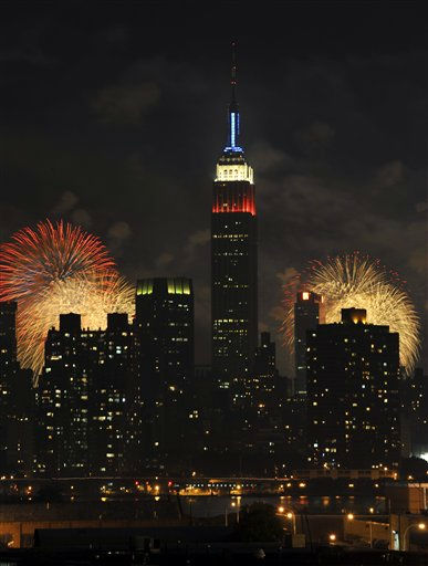 The Empire State Building, illuminated with red, white and blue lights, is seen from across the East River in the Queens borough of New York, as fireworks exploding over the Hudson River during the Macy&#39;s Fourth of July fireworks show on Monday, July 4, 2011 in New York. &#40;AP Photo&#47;Kathy Kmonicek&#41; <span class=meta>(AP Photo&#47; Kathy Kmonicek)</span>