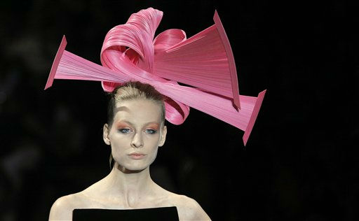 A model wears a creation for the Giorgio Armani Fall-Winter 2011-2012 Haute Couture fashion collection presented in Paris, Tuesday, July 5, 2011. &#40;AP Photo&#47;Jacques Brinon&#41; <span class=meta>(AP Photo&#47; Jacques Brinon)</span>