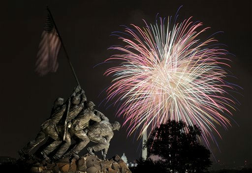 The United States Marine Corps War Memorial, better known as the Iwo Jima Memorial, is seen in Arlington, Va., Monday July 4, 2011, as fireworks burst over Washington, during the annual Fourth of July display. The Washington Monument and the Capitol can be seen in the distance. &#40;AP Photo&#47;Carolyn Kaster&#41; <span class=meta>(AP Photo&#47; Carolyn Kaster)</span>