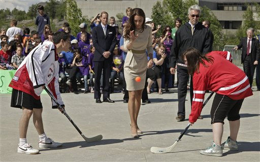 Kate, the Duchess of Cambridge, drops a ball as young hockey players face off during a welcome ceremony in Yellowknife, Canada as the Royal couple continue their Royal Tour of Canada Tuesday, July 5, 2011. &#40;AP Photo&#47;Charlie Riedel&#41; <span class=meta>(AP Photo&#47; Charlie Riedel)</span>