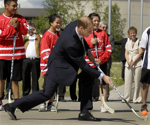 Prince William, the Duke of Cambridge, takes a shot as he visits kids playing street hockey during a welcome ceremony in Yellowknife, Canada as the Royal couple continue their Royal Tour of Canada Tuesday, July 5, 2011. &#40;AP Photo&#47;Charlie Riedel&#41; <span class=meta>(AP Photo&#47; Charlie Riedel)</span>