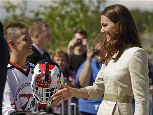 Kate, the Duchess of Cambridge, talks to a young hockey player during a welcome ceremony in Yellowknife, Northwest Territories as the Royal couple continue their Royal Tour of Canada Tuesday, July 5, 2011. &#40;AP Photo&#47;Charlie Riedel&#41; <span class=meta>(AP Photo&#47; Charlie Riedel)</span>