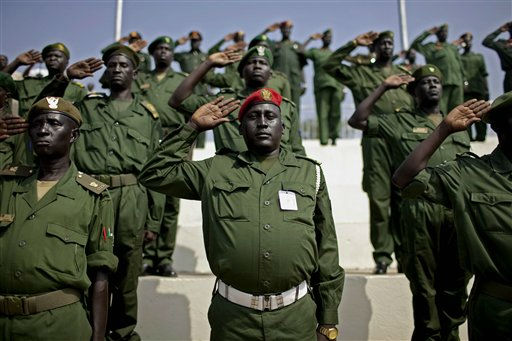 "<div class=""meta ""><span class=""caption-text "">Members of the Sudan People's Liberation Army stand at attention, during a rehearsal for independence,  in the southern capital of Juba on Tuesday, July 5, 2011. Southern Sudan is set to declare independence from the north on July 9, an event that follows decades of civil war between them. The Republic of South Sudan, as it will be named on Saturday, will be the world's 193rd country.  (AP Photo/Pete Muller) (AP Photo/ Pete Muller)</span></div>"