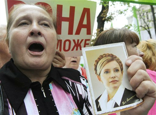 Supporters of Yulia Tymoshenko shout slogans during a rally in Kiev, Wednesday, July 6, 2011. The Ukrainian security service says it has opened a criminal investigation into the activities of an energy company once headed by former Prime Minister Yulia Tymoshenko. Tymoshenko, the country&#39;s top opposition leader, is already on trial on charges she abused her office in signing a natural gas import deal with Russia in 2009. Tymoshenko denies the accusations and says the trial is an attempt by President Viktor Yanukovych to bar her from politics. &#40;AP Photo&#47;Sergei Chuzavkov&#41; <span class=meta>(AP Photo&#47; Sergei Chuzavkov)</span>
