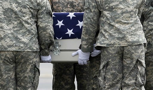 "<div class=""meta image-caption""><div class=""origin-logo origin-image ""><span></span></div><span class=""caption-text"">An Army carry team carries the transfer case containing the remains of Army Staff Sgt. Michael J. Garcia of Bossier City, La. upon arrival at Dover Air Force Base, Del. on Wednesday, July 6, 2011. The Department of Defense announced the death of Garcia who was supporting Operation Enduring Freedom in Afghanistan.(AP Photo/Jose Luis Magana) (AP Photo/ Jose Luis Magana)</span></div>"