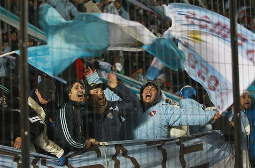 Argentina soccer fans cheer before the start of Group A Copa America soccer match between Argentina and Colombia in Santa Fe, Argentina, Wednesday July 6, 2011. &#40;AP Photo&#47;Victor R. Caivano&#41; <span class=meta>(AP Photo&#47; Victor R. Caivano)</span>