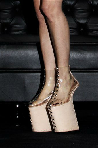 U.S. singer Lady Gaga stands in platform shoes during a press conference ahead of her showcase concert at the Marina Bay Sands on Thursday July 7, 2011 in Singapore. &#40;AP Photo&#47;Wong Maye-E&#41; <span class=meta>(AP Photo&#47; Wong Maye-E)</span>