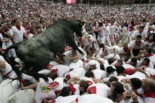 A calf, used as a game to amuse revelers jumps to the arena after the running of the bulls at the San Fermin fiestas on Thursday, July 7, 2011, in Pamplona, Spain.&#40;AP Photo&#47;Ivan Aguinaga&#41; <span class=meta>(AP Photo&#47; Ivan Aguinaga)</span>