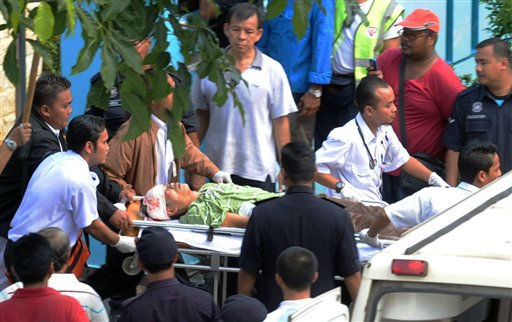 Malaysian paramedics carry an injured hostage-taker in a stretcher to an ambulance after police shot him in the head during an operation to end a hostage drama at a kindergarten in Muar, in the southern state of Johor, Malaysia, Thursday, July 7, 2011. &#40;AP Photo&#41; MALAYSIA OUT, NO SALES, NO ARCHIVE <span class=meta>(AP Photo&#47; Anonymous)</span>
