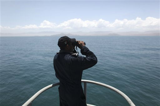 A Navy sailor, at the Madero war ship, looks through binoculars during the search and rescue efforts for the fishing vessel the Erik, which sunk on Sunday, near Punta Bufeo, Mexico, Thursday, July 7, 2011. Seven U.S. tourists are still missing four days after their boat capsized near this town as the Mexican navy and the U.S. Coast Guard expand their search in the Gulf of California. Most of the 27 passengers on board the ship were Northern California men who traveled to the gulf for an annual Independence Day fishing trip. &#40;AP Photo&#47;Alexandre Meneghini&#41; <span class=meta>(AP Photo&#47; Alexandre Meneghini)</span>