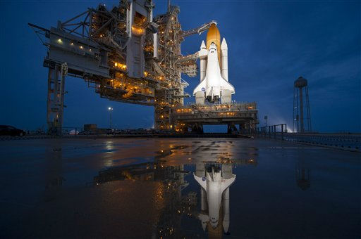 "<div class=""meta image-caption""><div class=""origin-logo origin-image ""><span></span></div><span class=""caption-text"">In this image provided by NASA, the space shuttle Atlantis is seen shortly after the rotating service structure (RSS) was rolled back at launch pad 39a, Thursday, July 7, 2011 at the NASA Kennedy Space Center in Cape Canaveral, Fla.  Atlantis is set to liftoff Friday on the final flight of the shuttle program, STS-135, a 12-day mission to the International Space Station. NASA decided to start the fueling operations early Friday morning.  (AP Photo/NASA, Bill Ingalls) (AP Photo/ Bill Ingalls)</span></div>"