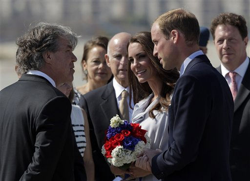 Prince William and Kate, the Duke and Duchess of Cambridge, talk to Canadian Consul General David Fransen, left, as they arrive at Los Angeles International Airport in Los Angeles, Friday, July 8, 2011. California Gov. Jerry Brown, background center, looks on. &#40;AP Photo&#47;Jae C. Hong&#41; <span class=meta>(AP Photo&#47; Jae C. Hong)</span>