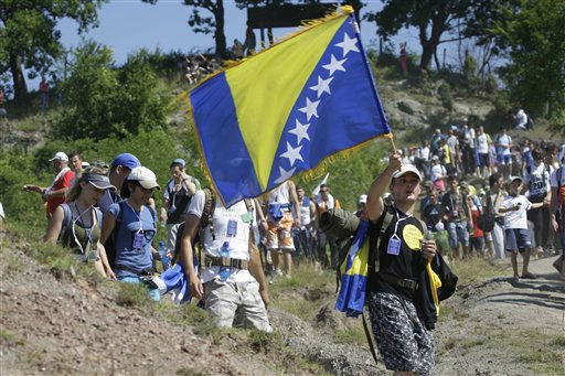 Participants of &#34;March of Peace&#34; march through dusty terrain near the village of Nezuk, 150 kms north east of Sarajevo,Bosnia, Friday, July 8, 2011. Several thousand people, including survivors of Europe&#39;s worst massacre since World War II, started a 110-kilometer  march from Nezuk to Srebrenica following the path along which Muslims fled Serb forces at Srebrenica 16 years ago.&#40;AP Photo&#47;Amel Emric&#41; <span class=meta>(AP Photo&#47; Amel Emric)</span>