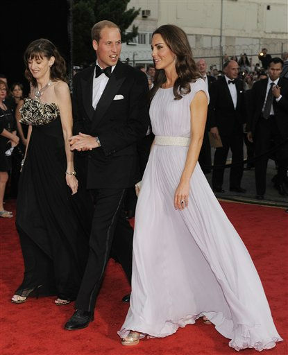 Prince William and Kate, the Duke and Duchess of Cambridge, arrive at the inaugural BAFTA Brits to Watch 2011 event at the Belasco Theater in Los Angeles, Saturday, July 9, 2011. At left is BAFTA chairman Amanda Berry. &#40;AP Photo&#47;Chris Pizzello&#41; <span class=meta>(AP Photo&#47; Chris Pizzello)</span>