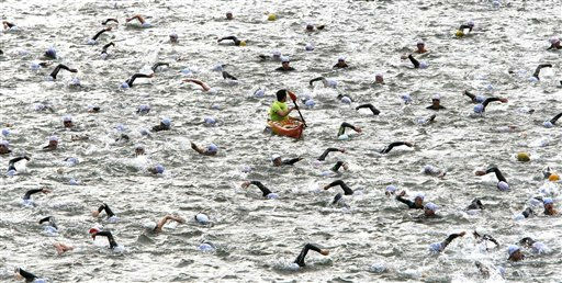 Competitors swim in the Seine River during the Paris Triathlon competition in Paris Sunday, July 10, 2011. &#40;AP Photo&#47;Lionel Cironneau &#41; <span class=meta>(AP Photo&#47; Lionel Cironneau)</span>