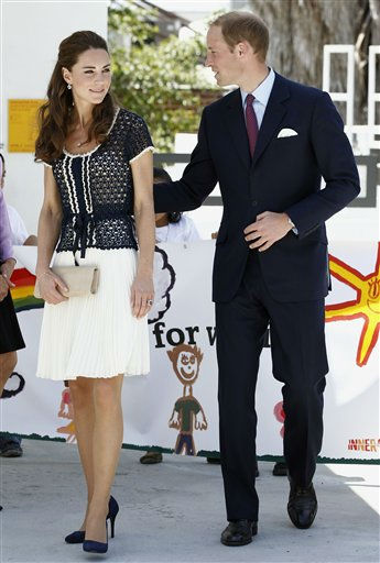 Prince William and his wife, Kate, the Duke and Duchess of Cambridge, leave an inner-city school in Los Angeles&#39;s notorious Skid Row area during the royal tour of California, Sunday, July 10, 2011. The royal couple were welcomed to the Inner City Arts academy by six elementary-aged children holding a welcome banner while a crowd of about 150 people looked on, some waving British and American flags. &#40;AP Photo&#47;Matt Sayles&#41; <span class=meta>(AP Photo&#47; Matt Sayles)</span>