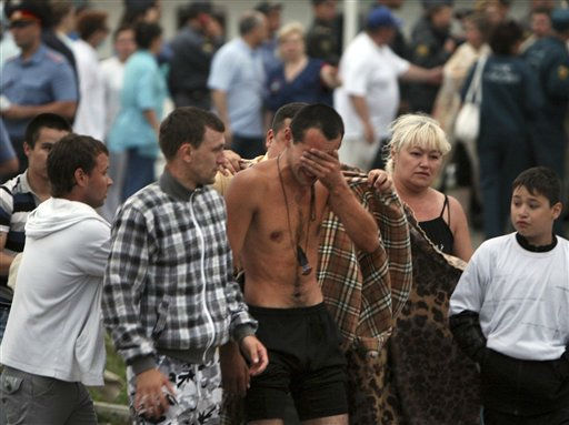 Families and friends help a survivor upon the arrival of the Arabella riverboat with dozens of survivors of a shipwreck in Kazan, on Sunday, July 10, 2011, on the Volga River, in central Russia.  A woman drowned and some 100 remain missing after the double-decker passenger boat sank in the middle of the river some 3 kilometers &#40;2 miles&#41; away from the nearest bank, in the Tatarstan region, about 450 miles &#40;750 kilometers&#41; east of Moscow. &#40;AP Photo&#47;Roman Kruchinin&#41; <span class=meta>(AP Photo&#47; Roman Kruchinin)</span>