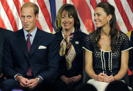 Prince William, the Duke of Cambridge, reacts to his introduction as Kate, Duchess of Cambridge, right, looks on during the Service Nation: Mission Serve Hiring Our Heroes Los Angeles job fair event at Sony Pictures Studios in Culver City, Calif., Sunday, July 10, 2011. &#40;AP Photo&#47;Chris Pizzello&#41; <span class=meta>(AP Photo&#47; Chris Pizzello)</span>