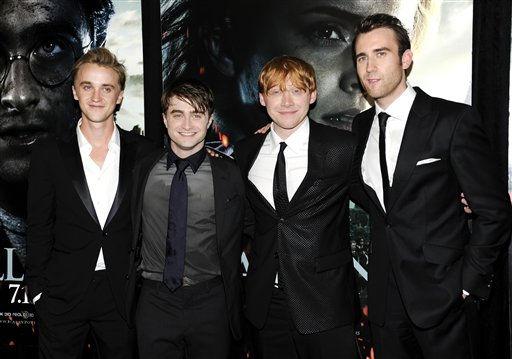 "<div class=""meta ""><span class=""caption-text "">Cast members, from left, Tom Felton, Daniel Radcliffe, Rupert Grint and Matthew Lewis pose together at the premiere of 'Harry Potter and the Deathly Hallows Part 2' at Avery Fisher Hall on Monday, July 11, 2011 in New York. (AP Photo/Evan Agostini) (AP Photo/ Evan Agostini)</span></div>"