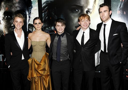 "<div class=""meta ""><span class=""caption-text "">Cast members, from left, Tom Felton, Emma Watson, Daniel Radcliffe, Rupert Grint and Matthew Lewis pose together at the premiere of 'Harry Potter and the Deathly Hallows Part 2' at Avery Fisher Hall on Monday, July 11, 2011 in New York. (AP Photo/Evan Agostini) (AP Photo/ Evan Agostini)</span></div>"
