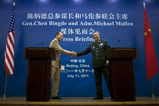 U.S. Adm. Mike Mullen, left, chairman of the Joint Chiefs of Staff, shakes hands with Gen. Chen Bingde, chief of the General Staff of the Chinese People&#39;s Liberation Army, after a press conference at the Bayi Building in Beijing, China, Monday, July 11, 2011. The United States is spending too much on its military in light of its recent economic troubles, China&#39;s top general Chen said Monday while playing down his country&#39;s own military capabilities. &#40;AP Photo&#47;Alexander F. Yuan, Pool&#41; <span class=meta>(AP Photo&#47; Alexander F. Yuan)</span>
