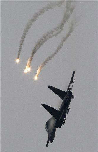 An Su-27 fighter releases flares as it demonstrates its capabilities during a visit by U.S. Adm. Mike Mullen, chairman of the Joint Chiefs of Staff, at the Division 19 Aviation PLA Air Force base in Jining at the Jinan military area in China, Tuesday, July 12, 2011. The top U.S. military officer is on a visit to China, the first of its kind in four years as the two governments are trying to improve military-to-military ties after setbacks over U.S. arms sales to Taiwan, cyberattacks traced to China and concern about Beijing&#39;s military plans. &#40;AP Photo&#47;Ng Han Guan&#41; <span class=meta>(AP Photo&#47; Ng Han Guan)</span>