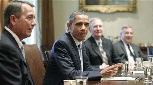 President Barack Obama sits with House Speaker John Boehner of Ohio, and Senate Minority Leader Mitch McConnell of Kentucky, and Sen. Dick Durbin, D-Ill., as he meets with Republican and Democratic leaders regarding the debt ceiling in the Cabinet Room of the White House in Washington, Wednesday, July 13, 2011. &#40;AP Photo&#47;Charles Dharapak&#41; <span class=meta>(AP Photo&#47; Charles Dharapak)</span>