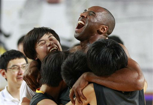NBA&#39;s Los Angeles Lakers Kobe Bryant embraces South Korean students in his basketball clinic for youth in Seoul, South Korea, Thursday, July 14, 2011.  Bryant is in Seoul during his five-Asian cities tour. &#40;AP Photo&#47;Lee Jin-man&#41; <span class=meta>(AP Photo&#47; Lee Jin-man)</span>