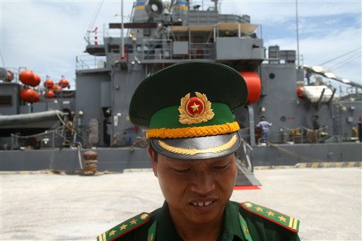 A Vietnamese naval officer stands in front of U.S. Navy salvage ship, USS Safeguard &#40;ARS-50&#41; during the ship&#39;s port call at Da Nang port in Da Nang, Vietnam, Friday, July. 15, 2011. U.S. and Vietnamese officials have stressed that the seven-day ship visit and naval training are part of routine exchanges planned long before tensions began flaring between China and Vietnam in late May. China has criticized the port call as inappropriate, saying it should have been rescheduled due to the ongoing squabble. &#40;AP Photo&#47;Na Son Nguyen&#41; <span class=meta>(AP Photo&#47; Na Son Nguyen)</span>