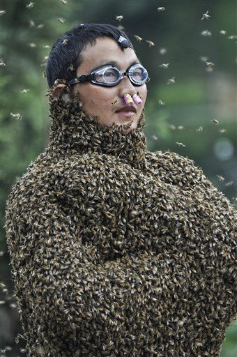 "<div class=""meta image-caption""><div class=""origin-logo origin-image ""><span></span></div><span class=""caption-text"">In this photo taken Saturday, July 16, 2011, beekeeper Wang Dalin wears tens of thousands of bees during a bee bearding contest in Longhui county, Shaoyang, in central China's Hunan province. (AP Photo) CHINA OUT (AP Photo/ Anonymous)</span></div>"
