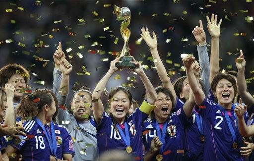 Japan players celebrate with the trophy after winning the final match between Japan and the United States at the Women?s Soccer World Cup in Frankfurt, Germany, Sunday, July 17, 2011. The Japanese women&#39;s soccer team won their first World Cup Sunday after defeating USA in a penalty shoot-out.&#40;AP Photo&#47;Michael Probst&#41; <span class=meta>(AP Photo&#47; Michael Probst)</span>