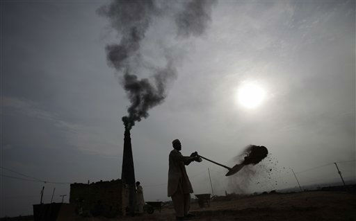 A Pakistani man works in a brick factory on the outskirts of Islamabad, Pakistan, Monday, July 18, 2011. &#40;AP Photo&#47;Muhammed Muheisen&#41; <span class=meta>(AP Photo&#47; Muhammed Muheisen)</span>