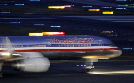 An American Airlines jet taxis on a runway as it takes off at Logan International Airport in Boston Tuesday, July 19, 2011. American?s parent, AMR Corp., said Wednesday, July 20, it will buy 260 planes from Airbus and 200 from Boeing. It will also take options and purchase rights for up to 465 additional planes through 2025.  &#40;AP Photo&#47;Elise Amendola&#41; <span class=meta>(AP Photo&#47; Elise Amendola)</span>