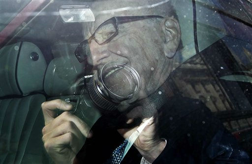 Media mogul Rupert Murdoch is driven along Whitehall in central London, Tuesday, July 19, 2011, with reflections seen in the car window.   Murdoch and his son James Murdoch are scheduled to be questioned by a parliamentary committee of British lawmakers Tuesday over the phone hacking scandal.  &#40;AP Photo&#47;Matt Dunham&#41; <span class=meta>(AP Photo&#47; Matt Dunham)</span>