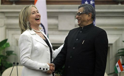 U.S. Secretary of State Hillary Rodham Clinton, left, shakes hands with Indian Foreign Minister S.M. Krishna at the end of a joint press conference in New Delhi, India, Tuesday, July 19, 2011. Clinton said Tuesday that the United States was &#34;encouraged&#34; by the revived peace talks between nuclear-armed rivals India and Pakistan. Clinton spoke at the news conference after she talked with top Indian officials about Pakistan, the U.S. withdrawal plans for Afghanistan and ways to broaden economic ties between the United States and India. &#40;AP Photo&#47;Saurabh Das&#41; <span class=meta>(AP Photo&#47; Saurabh Das)</span>