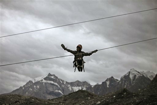 In this July 19, 2011 photo, an Indian army soldier trains on a high rope at the Siachen base camp, in Indian Kashmir on the border with Pakistan. The nuclear-armed South Asian nations have competing territorial claims to Siachen, often dubbed the world&#39;s highest battlefield, and troops have been locked in a standoff there at an altitude of up to 20,000 feet &#40;6,100-meter&#41; since 1984, when Indian forces occupied the glacier. Indian and Pakistani foreign secretaries held talks Tuesday against the backdrop of a recent terror attack that killed 20 people in India&#39;s financial capital, ahead of the countries&#39; foreign ministers meet Wednesday. &#40;AP Photo&#47;Channi Anand&#41; <span class=meta>(AP Photo&#47; Channi Anand)</span>