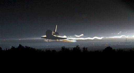 In this image provided by NASA, Space Shuttle Atlantis touches down at NASA&#39;s Kennedy Space Center Shuttle Landing Facility in Cape Canaveral, Fla., completing its 13-day mission to the International Space Station and the final flight of the Space Shuttle Program, early Thursday morning, July 21, 2011. Atlantis, the fourth orbiter built, launched on its first mission on Oct. 3, 1985. &#40;AP Photo&#47;NASA - Bill Ingalls&#41; <span class=meta>(AP Photo&#47; Bill Ingalls)</span>