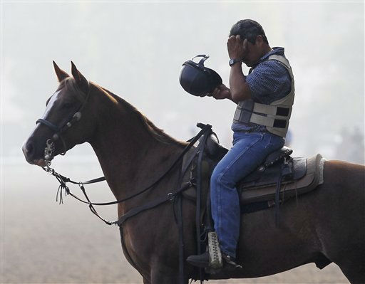 Head outrider Miguel Gutierrez cools off while watching horses during morning workouts at Saratoga Race Course in Saratoga Springs, N.Y., on Thursday, July 21, 2011. Communities across upstate New York are preparing for hot, humid weather as the National Weather Service issues a mix of excessive heat watches and warnings. &#40;AP Photo&#47;Mike Groll&#41; <span class=meta>(AP Photo&#47; Mike Groll)</span>