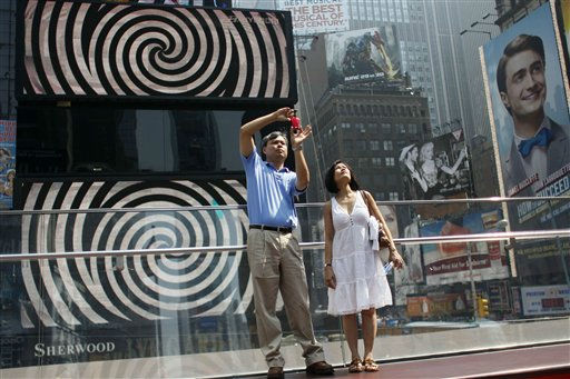 Thuan Nguyen, left, and Tuyet Ho, take in the view of New York&#39;s Times Square from the top of the TKTS staircase,  Thursday, July 21, 2011.   A heatwave that has enveloped much of the central part of the country for the past couple of weeks is moving east and temperatures are expected to top the 100-degree.  &#40;AP Photo&#47;Mary Altaffer&#41; <span class=meta>(AP Photo&#47; Mary Altaffer)</span>