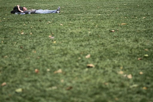 A lone man lays in the sun on the lawn at Bryant Park, Thursday, July 21, 2011 in New York.  A heat wave that has enveloped much of the central part of the country for the past couple of weeks is moving east and temperatures are expected to top the 100-degree. &#40;AP Photo&#47;Mary Altaffer&#41; <span class=meta>(AP Photo&#47; Mary Altaffer)</span>