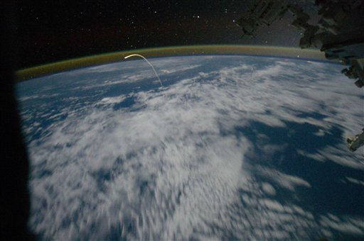 "<div class=""meta image-caption""><div class=""origin-logo origin-image ""><span></span></div><span class=""caption-text"">In this Thursday, July 21, 2011 picture made available by NASA, the space shuttle Atlantis returns to earth, photographed by the crew of the International Space Station. Atlantis and four astronauts returned from the International Space Station Thursday, bringing an end to NASA's 30-year shuttle journey. (AP Photo/NASA) (AP Photo/ Anonymous)</span></div>"