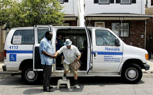 George Spratley, left, helps Domingo Belo, 83, get off a city van as Belo and his, Maria Belo, 81, get dropped off at their residence after attending a gathering at the Ironbound Senior Center, Thursday, July 21, 2011, in Newark, N.J. The elderly couple, which usually walk home from the center, were driven because the staff felt the hot weather would be too dangerous for the walk. Temperatures in the North New Jersey region neared the 100-degree mark. &#40;AP Photo&#47;Julio Cortez&#41; <span class=meta>(AP Photo&#47; Julio Cortez)</span>
