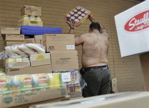 Eddie Ortiz unloads palettes of groceries outside a grocery store in New York, Thursday, July 21, 2011. Because the delivery was four hours late, Ortiz was working through the hottest part of the day.  Hot weather that has plagued the Plains for days spread eastward Thursday, blanketing several more states under a sizzling sun and excessive heat warnings that made people sick, shut down summer schools and spurred cities to offer cooling centers and free swimming. &#40;AP Photo&#47;Seth Wenig&#41; <span class=meta>(AP Photo&#47; Seth Wenig)</span>