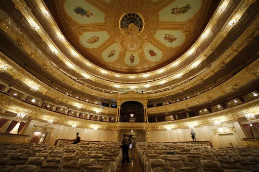 Members of the media are seen in the main hall of the Bolshoi Theater in Moscow, Russia, Friday, July 22, 2011, during a press tour organized by restorers. The historic building  is expected to reopen in the fall of 2011 after a long reconstruction. &#40;AP Photo&#47;Alexander Zemlianichenko&#41; <span class=meta>(AP Photo&#47; Alexander Zemlianichenko)</span>